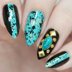 Turquoise, Black, and Gold Stiletto Nails.