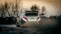 Rally car on gravel muddy track by DavorDjopar