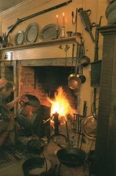 Tasha Tudor's fireplace. She was the queen of old fashioned things, wasn't she? I liked her books & drawings.