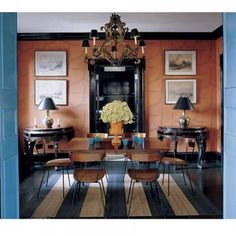 Love the terra cotta walls and striped rug!