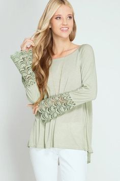 This light olive long sleeve top has lace contrast bell sleeves and a great addition to your spring wardrobe. FEAUTURES: - 70%COTTON - 30%RAYON - Model is 5'9 and wearing a size small - Size fits: Sma