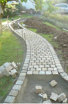 Amazing DIY Garden Path and Walkways Ideas 42 Amazing DIY Garden Path and Walkways Ideas A paver walkway can add an attractive touch to your landscape Interlocking pave. Paver Walkway, Driveway Landscaping, Cobblestone Walkway, Walkways, Driveways, Paver Sidewalk, Sidewalk Ideas, Concrete Walkway, Front Walkway