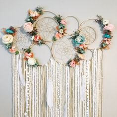 I am so loving the color combo on the florals in this piece! Theres a matching mobile in my shop as well. There are 7 bare wood hoops connected, 2 of which have hoops within them, and 4 hoops have sparkle twine webs, 2 of which are hand woven[. Grand Dream Catcher, Dream Catcher Nursery, Large Dream Catcher, Diy Dream Catcher, Homemade Dream Catchers, Dream Catcher Wedding, Making Dream Catchers, Dream Catcher Mobile, Diy And Crafts