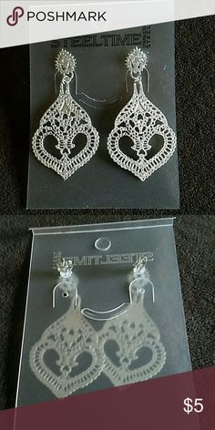 Silver Glitter Earrings NWOT Approx. 2.5 inches long 1.25 inches wide. NWOT Jewelry Earrings