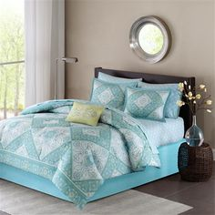 Update your space with the subtle colors in the Madison Park Essentials Complete Bed Set. This updated paisley design sits inside of a chevron for the perfect balance between modern and casual. Soft tones of blue and green work through the top of bed and three decorative pillows with embroidery and fabric manipulation. A decorative sheet set features a soft blue floral medallion motif. Sheet set includes: flat sheet, fitted sheet, and two pillowcases.