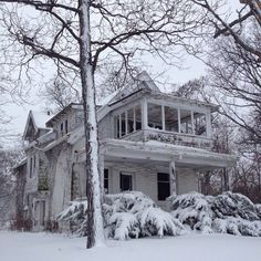 Freshly fallen snow adds beauty to this abandoned Milwaukee home.