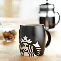 I have this one in white & green but I'm sure I need this one too. Starbucks Logo Mug