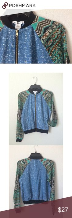 Printed Chambray Bomber Jacket Brand new, with tags! 🏷 An amazing vintage feel! You'll be sure to stand out in this!! Gold zipper, sheer printed sleeves, cuffed sleeves ends, and two pockets. Body material is 65% Cotton and 35% Polyester, and the sleeves are 100% Polyester. Size small. Say What? Jackets & Coats Utility Jackets
