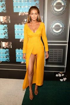 Golden girl GIgi Hadid in a Emilia Wickstead yellow dress at the VMAs
