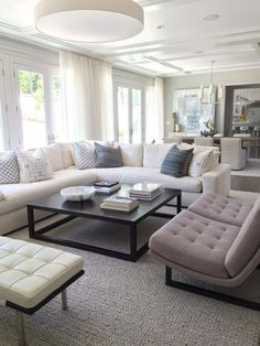 Plush seating and a large, square coffee table create a cozy living room