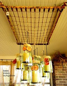 Bottomless jars made into candle holders hang from an old crib spring suspended from the ceiling. Old Bed Springs, Mattress Springs, Mattress Frame, Old Mattress, Pan Hanger, Crib Spring, Old Cribs, Old Beds, Mason Jar Candles
