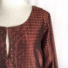 """Dana Buchman Silk Blend Brocade Tunic✨Host Pick✨ Richly textured brown tunic with orange and pink square flower pattern. Embellished with bronze tone beading around the collar, cuffs and hem. Three quarter sleeves and side slits on bottom of hem. 56% silk; 44% polyester. Dry clean. Size 2. Bust: 18.5"""" flat across. Waist: 18"""" across. Shoulder to shoulder: 15"""". Length: 28"""". Like new condition. Thanks for looking! Dana Buchman Tops Tunics"""