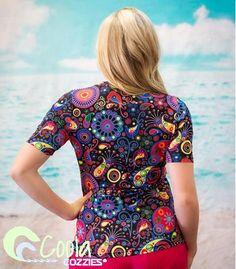 Coola Cozzies women's UPF50+ short sleeve rashie/swim shirt in sizes 10 to 24. Fireworks.  #womensswimwear #swimwear #coveredswimwear