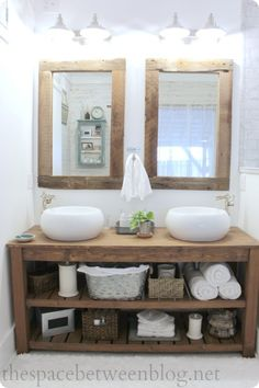 timber vanity, different white sinks, exposed copper piping and taps?