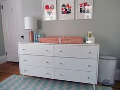 Love this  peach/orange/gray color scheme for little girl. Walls stonington gray. Rug from Urban outfitter, Ikea-rocker and Ribba picture ledge shelving. Zuzuprint ( )Crib sheet Little Auggie in Pebble gray. Ver Neuman-the Lucky Fish.  Love it all!