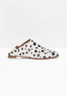 With extended coverage on the upper and an ultra-soft heel counter, these textured leather flats with a dalmatian print are a comfortable and demurley cool interpretation of  masculine footwear.
