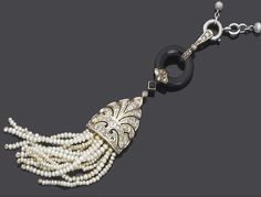 A seed pearl, onyx and diamond sautoir, circa 1920  The seed pearl sautoir necklace with circular-link connections suspending an onyx ring with rose-cut diamond suspension loop and trefoil suspending a pierced rose-cut diamond cupola with smaller seed pearl tassel, maker's mark, Austrian assay marks, necklace length 80.0cm., pendant length 7.9cm.
