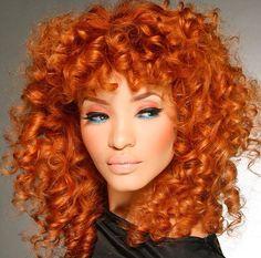 Orange curly hair, blue eyeliner.