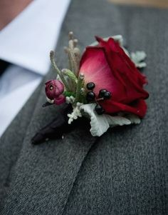 A deep red rose buttonhole with Ranunculus, Dusty Miller, Brunia and Ivy berries. designed by Lullah Belle Flowers http://www.lullahbelle.co.uk