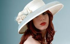 Greenwich Hat, Ivory parasisal picture hat overlaid with pearl blue sinamay  finished with silk dupion flowers.