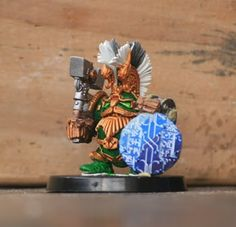Squat Clan Champion (Bob OLLEY Exo Squat with Fyreslayer plumes and magnetised arms).