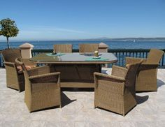 """Nova Outdoor Patio Resin Wicker Rectangle Dining Chair Table 7 Piece Set by urbandesignfurnishings.com. $1799.00. Chair dimensions: 28"""" wide x 28"""" deep x 35"""" high.. 5 choices of Sunbrella brand fabric to choose from.. Cushions made in USA.. 7pc set includes: 6-Chairs, and 1-Rectangle Table with tempered glass top.?. Table dimensions: 42"""" x 72"""", 29"""" high.. The Nova Dining Set is crafted of a synthetic wicker based on polyethylene, which beautifully captures the design o..."""