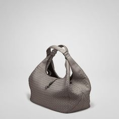"The bag is roomy with its wide bottom, but maintains a delicate appeal, making it the perfect day to evening bag.Dimensions:10.6"" W x 15.4"" H x 6.7"" D"