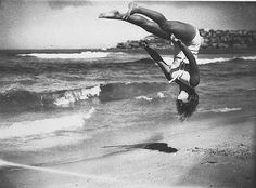 Ted Hood | Peggy Bacon in mid-air backflip, Bondi Beach, Sydney | 6/2/1937