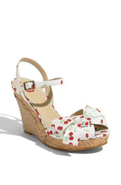 Braided rope covers the back of a towering cork-wedge heel elevating a   Nordstrom Shoe Clearance - $32.90 -cherry-printed sandal styled with a pleated, bow-decked vamp.