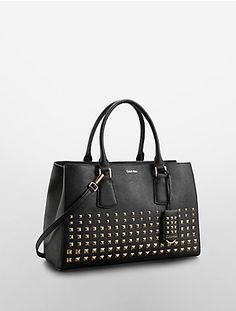 this saffiano leather tote bag features a studded front and dual handles with a detachable shoulder strap.