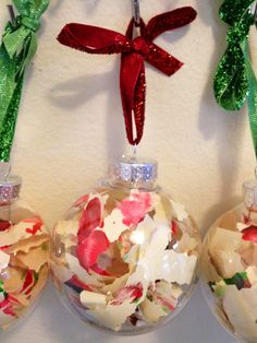Finger painting christmas ornament. Fun and easy craft for toddlers to make for their grandparents or teacher. Fingerpaint red and green on nice paper, cut in strips with edging scissors & stuff into empty clear ornaments. Tie bow with pretty holiday ribbon. Write child's name and the year on one strip.