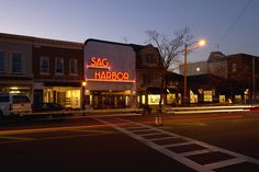 Sag Harbor Village, NY: Evening in Sag Harbor, with a view of the famous movie theater sign. Photo by Brown Harris Stevens of the Hamptons.