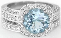 Original inspiration: pave halo aquamarine set. Love the contrast between the squared halo and the round stone.