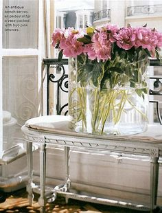 Peonies on antique table.