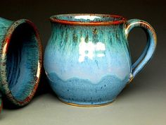 Blue Ceramic Coffee Mug. 3 1/2 tall, 3&1/2 wide. Holds 14 0z This listing is for ONE ceramic mug. Each piece of Darshan Pottery is hand thrown