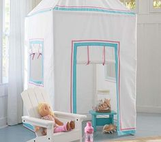 I'm obsessed with this Preppy Playhouse by Pottery Barn Kids. Any of the white modern Little Nest pieces would look so chic next to this tent.