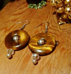 Just in: Real tiger's eye and Austrian crystal bohemian statement earrings, silver statement earrings, bohemian earrings, large statement earrings https://www.etsy.com/listing/555201976/real-tigers-eye-and-austrian-crystal?utm_campaign=crowdfire&utm_content=crowdfire&utm_medium=social&utm_source=pinterest