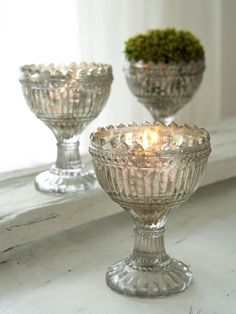 This lovely vintage glass tea light holder is reminiscent of days gone by...