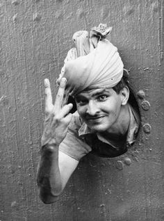 "An Indian soldier gives the ""V"" sign from the port-hole of a ship as he arrives at Singapore, Dec. 1941. Indian soldiers were all volunteers during WWII and became  the largest volunteer army in history, rising to over 2.5 million men in August 1945. ☚"