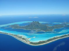 The island of Bora Bora lies on what is considered probably the most beautiful lake in the world, a huge pool of crystal clear water reveals a succession of blue and turquoise hues of the seabed. Protecting the island and lagoon, a barrier reef surrounds much of the atoll. The total area of Bora Bora is 29.3 km2. §