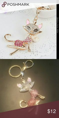 Pink rhinestone cat key chain Pink rhinestone cat key chain.  The cay is 3 1/4 inches long. Very cute and sparkly. Accessories Key & Card Holders