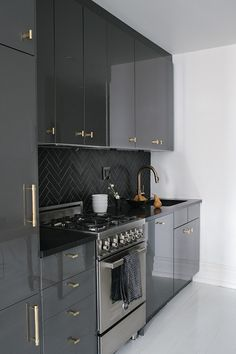 Contemporary Modern Kitchen: Contemporary kitchen with black cabinets and gold hardware.