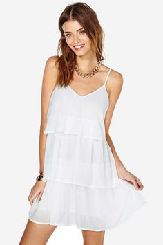 No need to look for the party-- in this dress, you are the party wherever you go.  Features tiere...