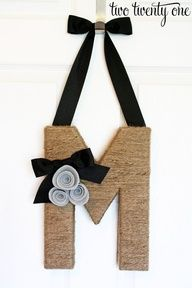 Jute twine wrapped monogram wreath.  Ooooh!  Maybe hung between family pictures on the wall.