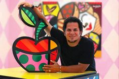 Romero Britto, a Brazilian-American Neo-pop artist, painter, serigrapher, and sculptor. He combines elements of cubism, pop art and graffiti painting in his work. Britto has lived in Miami, Florida since 1989