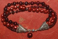 Hand knotted faceted dark red fresh water pearls, faceted Mozambique garnet and Bali sterling silver beaded bracelet Strand Bracelet, Beaded Bracelets, Sterling Silver Bead Bracelet, Water Pearls, Earrings Photo, Silver Beads, Dark Red, Ear Piercings, Fresh Water