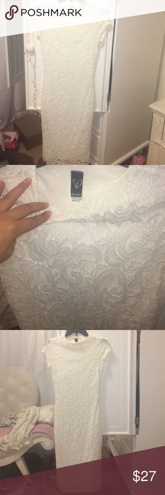 Body con dress This has been used once for my graduation. It is super tight on the body showing off curves. It goes below the knee and is all white lace. WINDSOR Dresses Midi