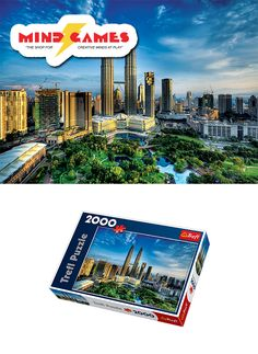 """The Petronas Twin Towers are a pair of twin skyscrapers located in Kuala Lumpur in Malaysia. Contains 88 floors, the Petronas Twin Towers still stands as one of the most tallest twin towers to date. Now you can construct your own version of the Petronas Twin Towers at home with the Petronas Twin Towers 2000-Piece Jigsaw!  Finished puzzle size: 38"""" x 27""""  The Petronas Twin Towers 2000-Piece Jigsaw contains 2000 puzzle pieces and is recommended for ages 12 and up."""