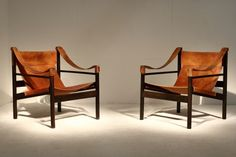 pair-of-leather-and-wood-chairs