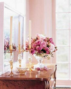 pink flowers and pillar candles centerpieces